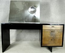 A mid century vintage lacquered dressing table with mirror inset with concave vanity glass and metal
