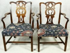 A pair of Georgian mahogany Chippendale style open armchairs with pierced back splat on chamfered