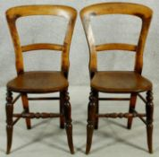 A pair of Victorian beech framed bedroom chairs. H.83cm