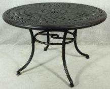 A metal framed garden table with latticework top. H.75 D.120cm