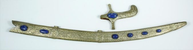 An Indian white metal foliate repousse and floral engraved sword scabbard and hilt set with Lapis