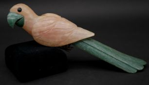 A carved rose quartz and aventurine parrot sculpture with white metal engraved feet. L.26.5cm