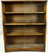 A vintage teak bookcase with sliding glass plate doors. H.113 W.91 D.24cm