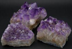 Three large amethyst crystal pieces. H.11 L.15 W.14cm