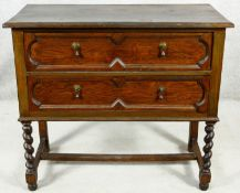 A mid century Jacobean style two drawer oak chest on stretchered barleytwist supports. H.80 W.90 D.