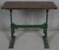 A 19th century cast iron pub table with mahogany top the base marked; Gaskell and Chambers,