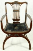 A mahogany Chippendale style X framed armchair with pierced and carved vase shaped back splat. H.