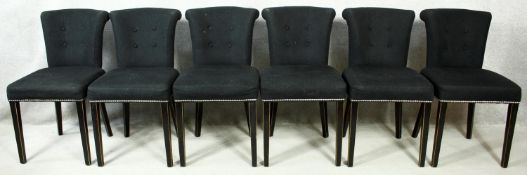 A set of six Eichholtz Largo dining chairs in studded cashmere upholstery. H.86cm