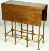 A 19th century mahogany drop flap table on turned spider leg supports. H.71 W.83 D.71cm