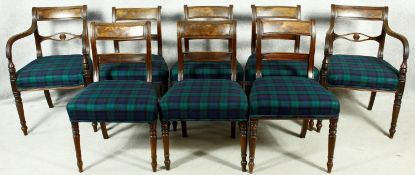 A set of eight late Georgian mahogany dining chairs with flame mahogany bar backs and Black Watch