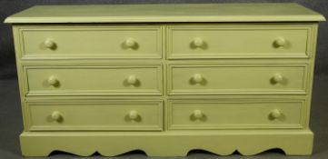 A Victorian style painted small chest of six short drawers on shaped bracket feet. H.65 W.133 D.41cm