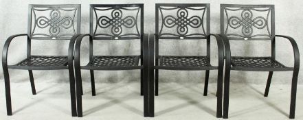 A set of four metal framed garden chairs with latticework seats. H.87