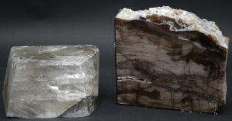 A large smokey quartz crystal and a piece of polished petrified wood. H.13 L.14 W.4.5cm (Petrified
