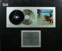 A framed producers presentation for sales of 600,000 copies of Fat of the Land by The Prodigy. H.