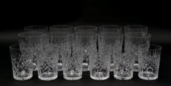 A collection of sixteen glass tumblers with stylized foliate design. Various sizes. H.10.5cm