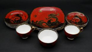 A part New Chelsea Staffordshire gilded hand painted bone china black dragon design on red ground