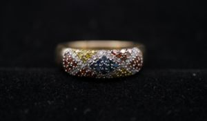 A 9 carat yellow gold and coloured diamond half eternity ring. Set to centre with nine round
