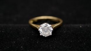 An 18 carat yellow gold and diamond solitaire ring. Set to centre with a round brilliant cut diamond