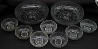 A collection of nine frosted cut glass bowls with engraved stylised foliate design and star cut