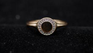 A cubic zirconia set 9 carat yellow gold signet ring. Set with twenty round brilliant cut cubic