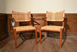 A pair of mid century Danish teak armchairs by Eric Worts with woven cane backs and seats. H.80 W.50