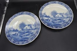 A pair of Dutch blue and white plates with maker's mark to base. Dia.39cm