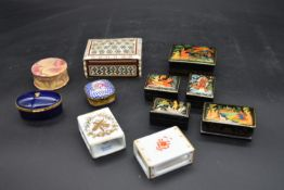 A Limoges porcelain pill box and a Limoges match box cover, a similar Herend example, a lidded