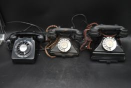 A vintage rotary dial bakelite telephone, another similar and a 1960's example. H.26 W.23 D.15cm