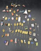 A large collection of vintage and antique advertising and society enamel tie pins and badges. L.