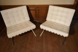 After Ludwig Mies van der Rohe, a pair of Barcelona chairs in white leather upholstery on chrome