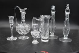 A small signed Lalique jar and stopper along with a pair of cut crystal candlesticks, a pair of