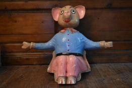A vintage fibreglass seated figure of a cartoon pig. H.60 W.80 D.30cm