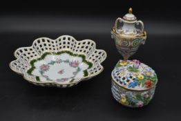 Three items of Dresden porcelain, a lidded pot, a pierced rim bowl and a Classical style lidded urn,
