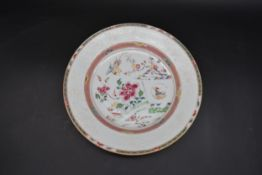An 18th century Famille Rose Chinese glazed porcelain plate with cuckoo and house design with