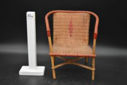 A vintage miniature wicker and cane tub shaped conservatory armchair. H.30 W.22cm