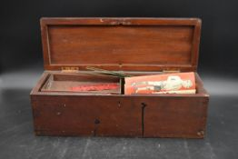 A 19th century mahogany box with fitted lift out trays containing various Mecano pieces. H.15 W.45
