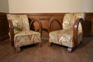 A pair of vintage French Art Deco style armchairs in floral silk upholstery. H.71 W.66 D.57cm