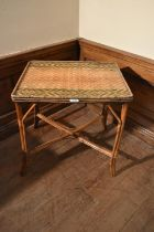A late 19th century Maison des Bambous, Paris bamboo and wicker occasional with label attached. H.