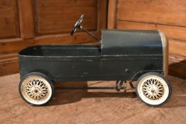 An early 20th century child's pedal car in original condition. H.35 W.75 D.33cm
