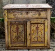 A 19th century French bureau with fall front above panel doors with all over scrolling hand
