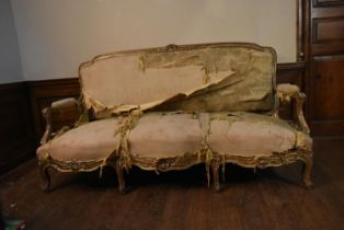 An 18th century Italian giltwood three seater canape in it's original and distressed upholstery