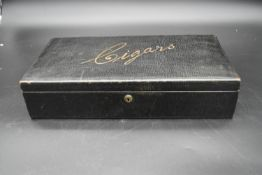 A C.1900 cedar lined leather bound cigar box with gilt embossed lettering. H.10 W.38 D.20cm