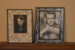 A pair of framed photographic portraits, one of Cary Grant. H.31 W.24cm (largest) (2)
