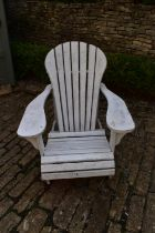 A vintage white painted and slatted garden reclining armchair. H.90 W.78 D.60cm