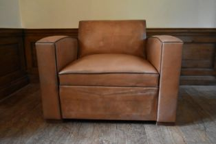 A vintage French leather upholstered armchair converting to single mattress base. H.81 W.106 D.
