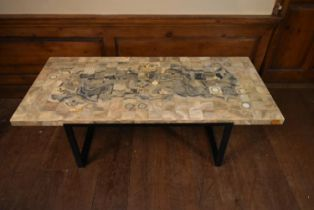 A mid century marble topped coffee table with square cut sections across the top raised on
