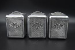 A set of three mid century French aluminium, cafe, sucre and chicoree canisters. H.16 W.12cm