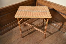 A late 19th century bamboo and wicker occasional table. H.76 W.72 D.46cm