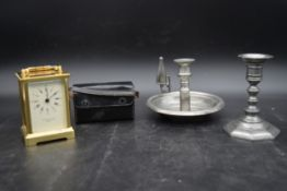 A brass Taylor and Bligh carriage clock with quartz movement, a pair of cased opera glasses, a