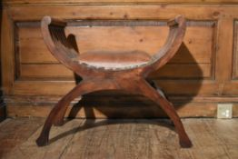 A contemporary teak X framed stool in leather upholstery. H.60 W.56 D.37cm